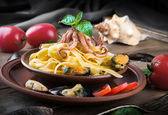Pasta with mussels and octopus — Stock Photo