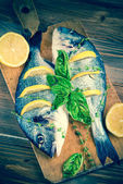 Fishes with lemon — Stock Photo