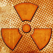 Sign of radiation on grunge background — Stock Photo