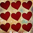 Stock Photo: Red hearts on grunge background