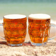 Stock Photo: Two glasses of cold beer on sebeach