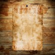 Stock Photo: Old western wanted poster on wooden background