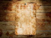 Old western wanted poster on wooden background — Stock Photo