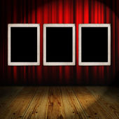 Red curtain with vintage frames — Foto de Stock