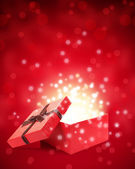 Open gift box with light insideout — Stock Photo
