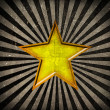 Orange star on grunge background — Stock Photo