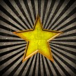 Stock Photo: Orange star on grunge background
