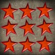 Orange star on grunge background - Stock Photo