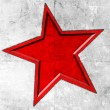 Red star on grunge background — Stock Photo