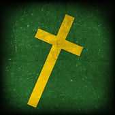 Cross on green grunge background — Stock Photo