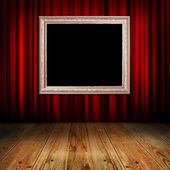 Red curtain with vintage frame — Stock Photo