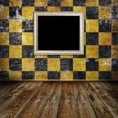 Empty frame in orange grunge room — Stock Photo