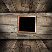 Empty frame in vintage wooden room — Stock Photo