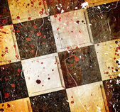 Grungy dotted chessboard background with stains — Stock Photo