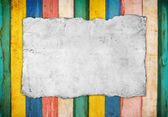 Old paper on the color wooden background — Stock Photo