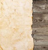 Old paper on the wood background — Stock Photo