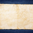 Vintage paper on blue jeans background — Stock Photo #24775861