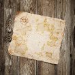 Old treasure map  on wooden background - Stock Photo