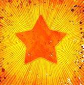 Grunge star on orange background — Stock Photo