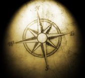 Old compass on paper background — Foto Stock