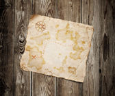 Old treasure map on wooden background — Photo