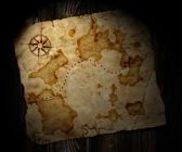 Old treasure map on wooden background — Stock fotografie
