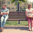 Stock Photo: Young couple at quarrel on bench in park