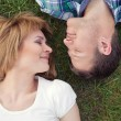 Young couple relaxing in park — Stock Photo