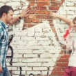 Young couple against graffiti wall — Stock Photo
