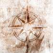 Royalty-Free Stock Photo: Old compass on paper background