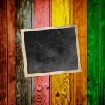 Blank Photo on Multicolored Wood Background — Stock Photo