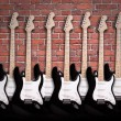 Electric guitars on brick wall — Stockfoto