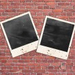 Photo frames on the brick wall — Stock Photo
