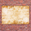 Vintage paper on old red brick wall — Stock Photo
