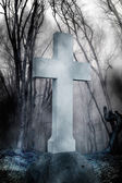 Cross in fog at the cemetery — Stock Photo
