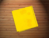 Yellow sticker paper note on vintage wood background — Stock Photo