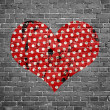 Dotted grunge heart on brick wall — Stock Photo