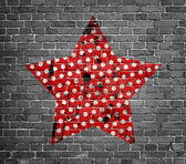 Dotted grunge star on brick wall — Stock Photo