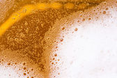Close up of beer with foam — Stock Photo