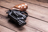 Pistol on a wood background — Stock Photo
