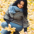 Young pretty woman in autumn park — Stock Photo