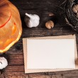 Stock Photo: Halloween background with sheet of paper and decoration