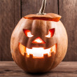 Stock Photo: Scary jack-o-lantern on wood