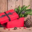 Stock Photo: Gift box with christmas elements on wooden background
