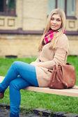 Girl sitting on bench — Stock Photo