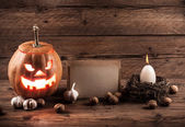 Halloween background with sheet of paper and decoration — Stock Photo