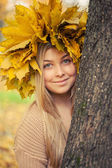 Young woman wearing a wreath of autumn leaves — Stock Photo