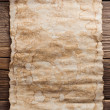 Old paper on wood background — Stock Photo