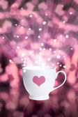 Coffee cup against bokeh background with hearts — Stock Photo