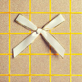 Top view of elegant gift box with bow — Stock Photo